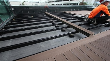 This large beautiful staff decking facility was build daylighting, floor, metal, roof, steel, wood, gray, black