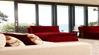 Cosy red sofas with Eurostacker sliding doors and furniture, home, interior design, living room, room, window, window covering, white