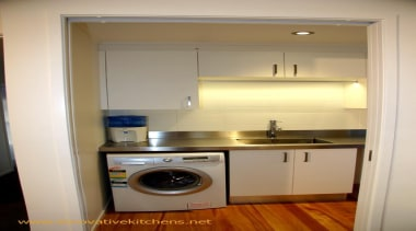 Laundry, clothes rail with LED lighting. - modern_glendowie_2013_6.jpg cabinetry, clothes dryer, countertop, home appliance, kitchen, laundry, laundry room, major appliance, property, room, washing machine, gray, brown