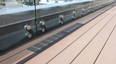 This large beautiful staff decking facility was build floor, infrastructure, line, wood, white, gray