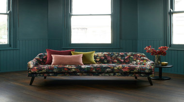 Flowerbomb features a majestic, ethereal bouquet of peonies, bed, bed frame, chaise longue, couch, flooring, furniture, home, interior design, living room, loveseat, sofa bed, studio couch, table, window, wood, black