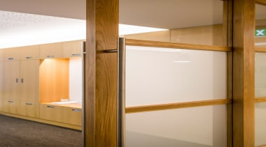 Our clients required a high quality fitout providing cabinetry, furniture, interior design, wall, wood, brown, white, orange