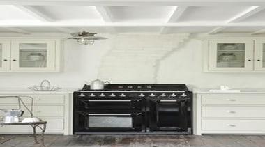 Smeg Victoria Aesthetic freestanding oven in a classic cabinetry, countertop, cuisine classique, floor, flooring, home appliance, interior design, kitchen, kitchen appliance, kitchen stove, major appliance, room, wood flooring, white