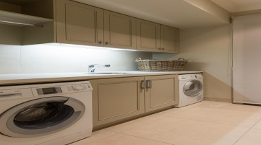 Mellons Bay 20 - cabinetry   clothes dryer cabinetry, clothes dryer, countertop, home appliance, kitchen, laundry, laundry room, major appliance, property, room, washing machine, brown