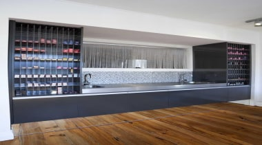 Cabinetry with a mirror at the base making cabinetry, flooring, furniture, interior design, shelf, shelving, white