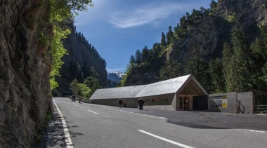 The visitor centre located at the top of alps, asphalt, infrastructure, landscape, mountain, mountain pass, mountain range, mountainous landforms, national park, plant, road, sky, tree, black