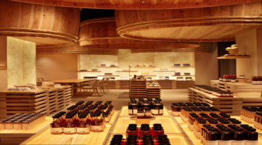 The Kayanoya Shop is a reproduction of a function hall, interior design, lobby, performing arts center, brown, orange