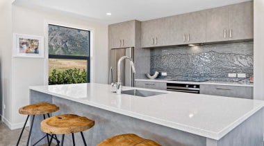 Capturing the flavour of Central Otago in the countertop, cuisine classique, floor, home, interior design, kitchen, real estate, tile, gray