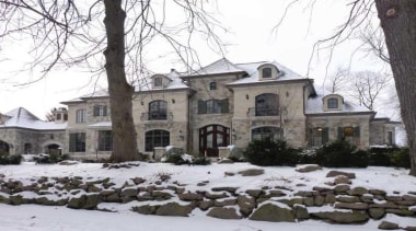 This home looks the part in a winter building, estate, facade, historic house, home, house, manor house, mansion, neighbourhood, property, real estate, residential area, snow, tree, window, winter, white, black