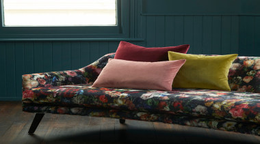 Flowerbomb features a majestic, ethereal bouquet of peonies, bed sheet, chair, couch, cushion, duvet cover, furniture, interior design, living room, loveseat, sofa bed, studio couch, textile, black