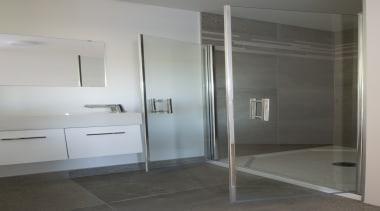 Batwing shower doors in the spare bathroom open bathroom, door, floor, glass, interior design, plumbing fixture, room, shower, gray