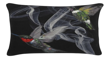 Jewel-like iridescent hummingbirds are hand woven in silk cushion, throw pillow, black, white