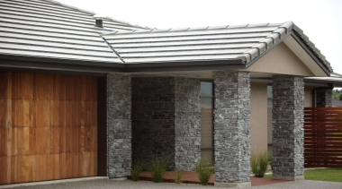 Make a statement from the moment people come door, facade, garage door, home, house, property, real estate, roof, siding