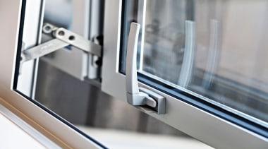 Architect Robyn Bilkey chose anodised aluminium joinery, from glass, product, window, gray, white