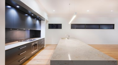The Pulsar kitchen island beautifully showcases the natural architecture, ceiling, countertop, floor, interior design, kitchen, real estate, room, wood flooring, white