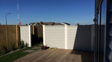 Simpler. Faster. Proven Weathertight. - A-lign Fencing - facade, home, house, outdoor structure, property, real estate, roof, siding, blue, black