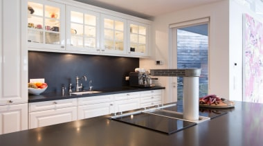 Contemporary technology is combined with timeless aesthetics and cabinetry, countertop, cuisine classique, home, home appliance, interior design, kitchen, room, gray