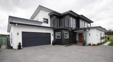 With easy access leading to this stunning customer building, elevation, estate, facade, home, house, property, real estate, residential area, siding, window, white, gray