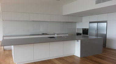 White Standard Glass Splashback. Taken at a different cabinetry, countertop, interior design, kitchen, property, real estate, gray