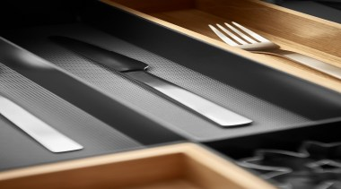 Open Space is a flexible drawer organizing system automotive design, automotive exterior, line, material, product, black