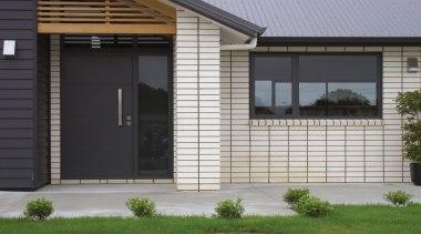 The perfect showcase of bricks versatility. Designed to door, facade, garage door, home, house, porch, property, real estate, residential area, siding, window, gray, black