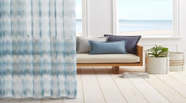 Serene and timeless, COAST combines a stylish ombre couch, curtain, cushion, floor, flooring, furniture, home, interior design, living room, product, textile, window, window blind, window covering, window treatment, wood, white