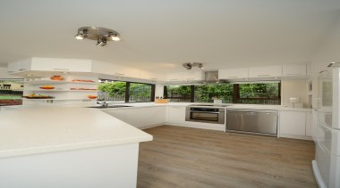 When it comes to shaping forms to follow countertop, floor, home, house, interior design, kitchen, real estate, room, gray