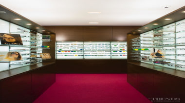 Island displays offer some privacy for shoppers. interior design, lobby, retail, red, white