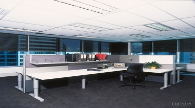 Partitions between desks are constructed from fabric-wrapped acoustic desk, furniture, office, black, white