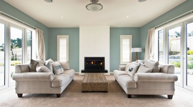 Bright blue and beige living room in Aotea ceiling, estate, floor, home, interior design, living room, property, real estate, room, window, white, gray