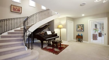 Entry with grand piano under the stairs - ceiling, estate, floor, flooring, handrail, hardwood, home, interior design, living room, property, real estate, room, stairs, wall, wood flooring, gray