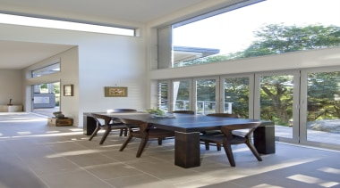 Bright dining area with wooden furniture - Landmark architecture, chair, daylighting, dining room, furniture, house, interior design, real estate, table, window, gray