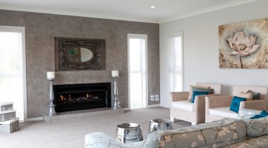 Family living room with fire place in Karapiro fireplace, floor, hearth, home, interior design, living room, room, wall, gray, white