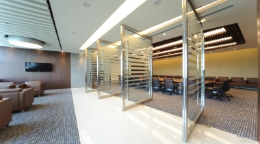 Meeting rooms have floor-to-ceiling swivel doors so spaces ceiling, interior design, real estate, gray