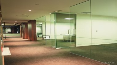 Glass wall partitioning separates some of the office architecture, ceiling, daylighting, floor, glass, handrail, house, interior design, lobby, real estate, wall, brown