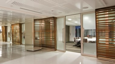 Below The office has an open-plan design to ceiling, floor, flooring, interior design, lobby, real estate, window covering, gray, brown