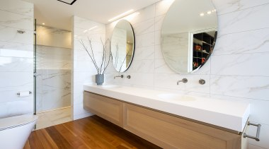 Filled with natural light, warm timber and marble