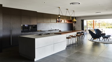 A large-scale functional kitchen was always at the architecture, building, cabinetry, ceiling, countertop, cupboard, design, floor, flooring, furniture, hardwood, home, house, interior design, kitchen, kitchen stove, loft, material property, property, real estate, room, table, tile, wall, gray, black