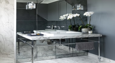 The bespoke mirrored wall and open stand style