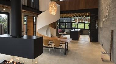 白色螺旋楼梯是整个空间最具流动感的元素。 flooring, furniture, interior design, lobby, table, black