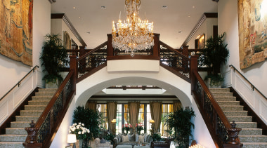 entranceway to house including atrium and dual staircase ceiling, estate, interior design, lobby, stairs, gray, white