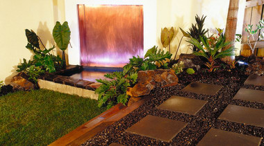 Copper water feature set in light coloured wall, flora, flower, garden, landscaping, plant, brown, black