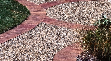 Aggregate concrete path bordered with terracotta coloured pavers. brickwork, cobblestone, driveway, flagstone, grass, gravel, landscape, landscaping, path, road surface, walkway, white