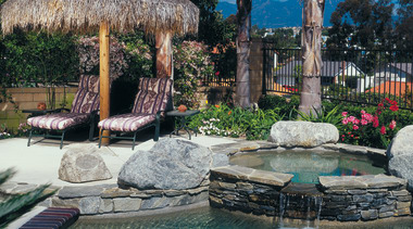 Pool area with water feature and outdoor furniture arecales, estate, landscape, landscaping, leisure, outdoor structure, palm tree, plant, real estate, reflection, resort, swimming pool, tree, water, water feature
