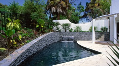 Black pool with sandstone paving, raised garden and arecales, backyard, estate, home, landscape, landscaping, leisure, outdoor structure, pond, property, real estate, resort, swimming pool, villa, water, water feature, yard