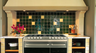 View of the cooking area - View of cabinetry, countertop, home appliance, interior design, kitchen, kitchen stove, orange