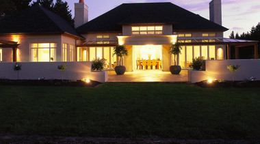 An exterior of a home - An exterior architecture, building, cottage, estate, evening, facade, home, house, landscape lighting, lighting, mansion, night, property, real estate, residential area, roof, sky, black