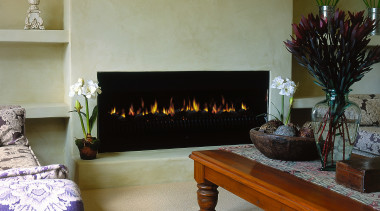 View of fireplace up close - View of fireplace, flooring, furniture, hearth, home, interior design, living room, room, table, brown, gray
