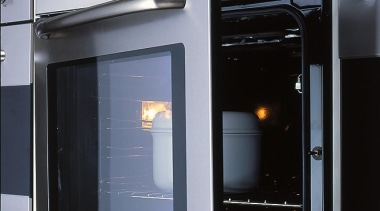 View of the kitchen appliance - View of gas stove, home appliance, kitchen appliance, kitchen stove, major appliance, microwave oven, oven, black, gray