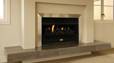 Indoor fireplace with cream and aluminium surround, and fireplace, hearth, heat, wood burning stove, orange, brown
